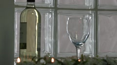 Isolated Shot of Bottle of White Wine and Wineglass Stock Footage