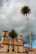 Old colonial stone church plaza with palm tree near Bogota Stock Photos