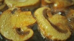 Frying field mushrooms macro dolly video - stock footage