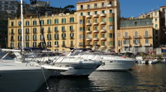 Small boats docked near the seafront in Naples, Italy Stock Footage