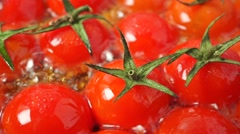 Roasting cherry tomatoes with leaves macro shot - stock footage