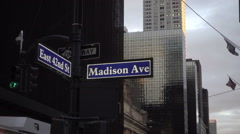 East 42nd Street and Madison Ave sign on street corner intersection, zooming out Stock Footage
