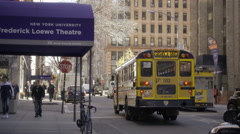 Frederick Loewe Theater at NYU with yellow school bus driving away NYC  Stock Footage