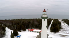 Scenic Aerial of Presque isle Light house in winter, forest, lake, and Sky 3 Stock Footage