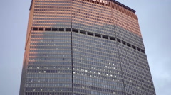 MetLife Building close up, tilting down to Grand Central Terminal corner of 42nd - stock footage