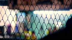 People In City At Night Through Fence Abstract Stock Footage