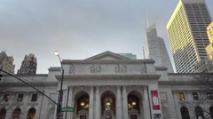 New York Public Library front steps and School of Rock ad in NYC Stock Footage