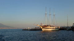 Old sailing vessel docked in the port of Naples Stock Footage