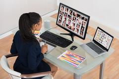 Young African Designer Retouching Photos On Computer Stock Photos