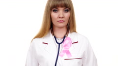 Woman doctor with stethoscope pink ribbon aids symbol 4K - stock footage