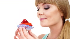 Stock Video Footage of Woman holds cupcake sweet food in hand 4K