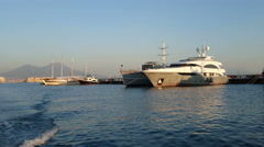 Luxury yachts docked in Naples at sunset Stock Footage