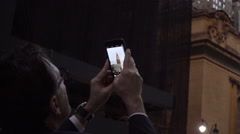 tourist man in suit, glasses taking smartphone picture Chrysler Building NYC - stock footage
