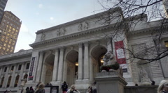 Woman taking picture of lion statue, New York Public Library in NYC Stock Footage