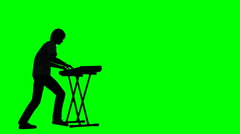 Young rock musician playing keyboard in silhouette on a green screen Stock Footage