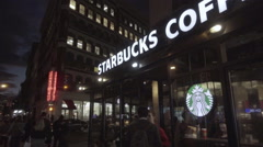 Astor Place at night, Starbucks Coffee panning to Cooper Square with people NYC Stock Footage