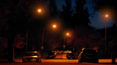 Cars Passing Through Suburbs At Night - stock footage