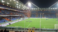 Teams training in Luigi Ferraris stadium in Genoa, Italy, before a soccer match Stock Footage