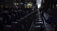 Citi Bike docking station early evening sunset, dark street bicycle 1080 HD NYC Stock Footage