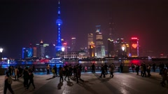 Hyperlapse night city view with people, river and skyscrapers. Shanghai Stock Footage