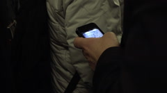 Close-up on hand using smartphone in crowded subway train car people 1080 HD Stock Footage