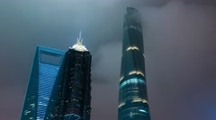 Night view of skyscrapers hiding in clouds at Lujiazui, Pudong. Shanghai Stock Footage