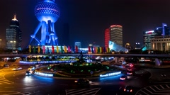 Shanghai - Night view of roundabout traffic and people on skywalk. Stock Footage
