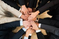 Directly above shot of business team stacking hands in office Kuvituskuvat