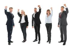 Full length portrait of cheerful business people celebrating success against  - stock photo