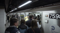 Crowded platform New York, people busy MTA subway man Yankee jacket Stock Footage