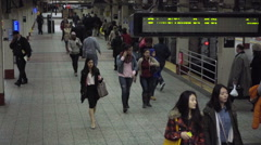 Commuters walking in slow motion, New Yorkers and travelers and tourists crowded Stock Footage