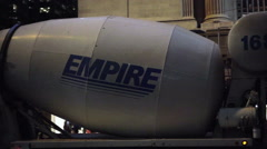 Empire cement truck rotating, spinning while driving in slow motion at night NYC Stock Footage