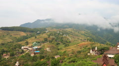 Cloud moving on mountain over village in rural area timelapse 4K UHD Stock Footage