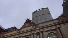 MetLife building tilting to Grand Central holiday wreath in evening NYC Stock Footage