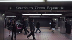Subway sign for S train aka Shuttle to Times Square in MTA station people NYC Stock Footage