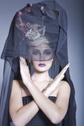 Lady wearing a long black veil - stock photo