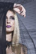 Fashionable blonde wrapped in a veil Stock Photos