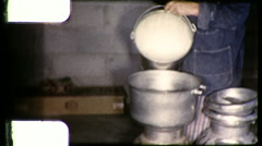 Woman Farmer DIARY FARM Pours Milk From Pail 1960s Vintage Film Home Movie 9298 Stock Footage