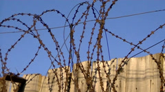 Barbed wire on a wooden fence - stock footage