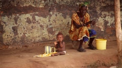 Grandma and baby playing in africa native village Stock Footage
