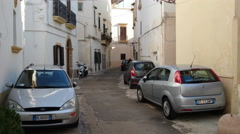 People walk in characteristic small street in Gallipoli, Italy - stock footage