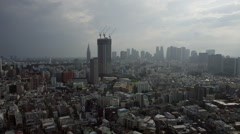 Slow pan right high elevation daytime panoramic view towards Shinjuku, Tokyo - stock footage