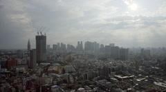 Static high elevation daytime panoramic view towards Shinjuku, Tokyo Stock Footage