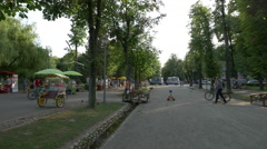 Adults and children relaxing in Central Park, Cluj-Napoca Stock Footage