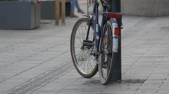 Bike leaning on a light pole in Cluj-Napoca Stock Footage