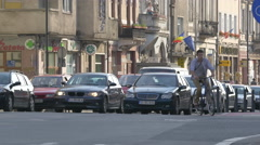 Riding bikes and driving cars on Cluj-Napoca Stock Footage