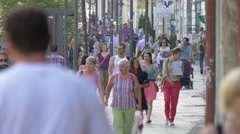 Tourists and locals walking on a street in Cluj-Napoca Stock Footage