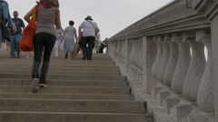 People walking on stairs on Ponte Degli Scalzi in Venice Stock Footage