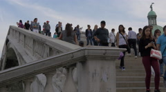 Tourists walking  on the stairs of Ponte Degli Scalzi in Venice Stock Footage