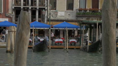 Gondolas moored in front of Bar Ristorante Omnibus in Venice Stock Footage